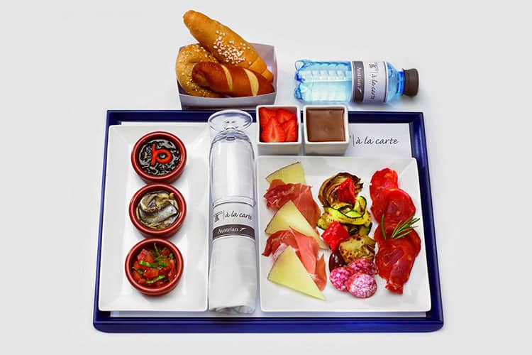 prepared airline food laid out on a white background