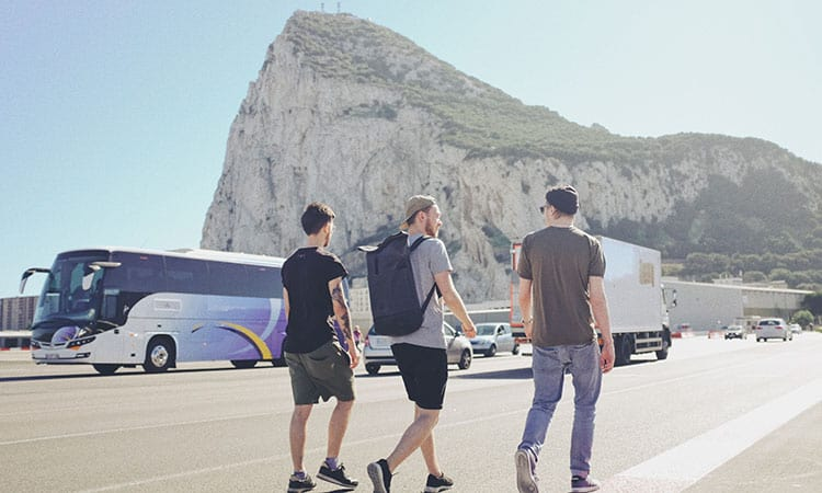 three men wearing casual clothes in the Gibraltar