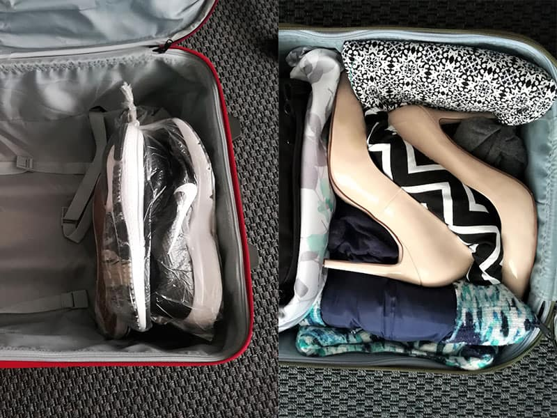 Sports shoes and high heels packed in a suitcase