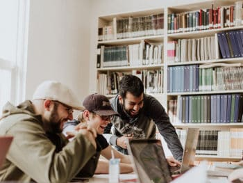 three study abroad students doing homework