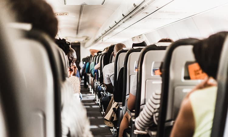 Passengers sitting on an airplane during flight