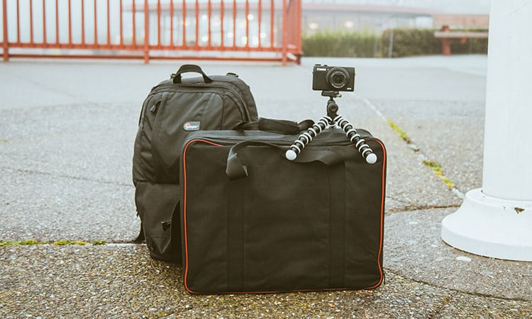 canon camera on top of lightweight hand baggage