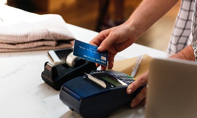 A man swiping a credit card for payment