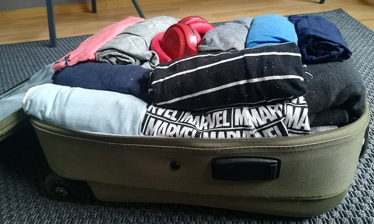 a suitcase packed without packing cubes