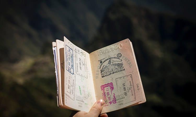 A girl holding an opened passport