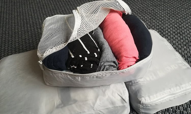 t-shirts rolled inside ikea packing cubes