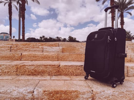 travelpro Maxlite 5 carry-on on stone staircase