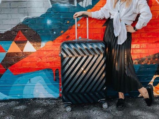 American tourister hardside on a colorful grafitti backdrop