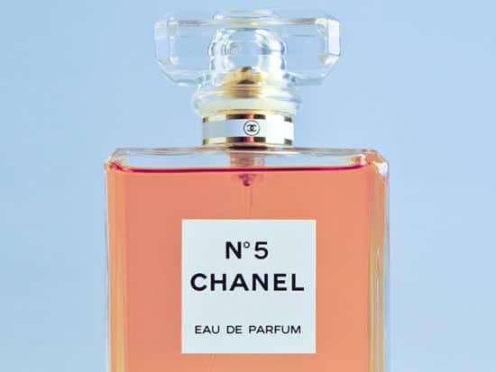 chanel perfume in rose gold on a blue background