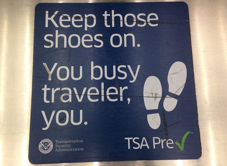 TSA precheck sign in an airport