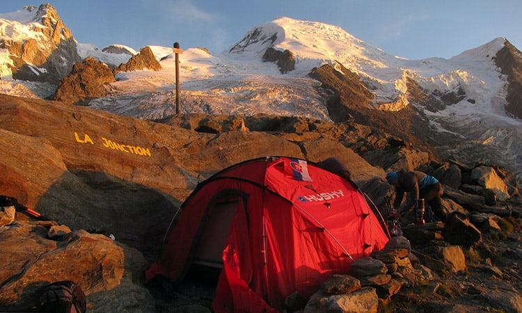 an assembled red tent in the alps france
