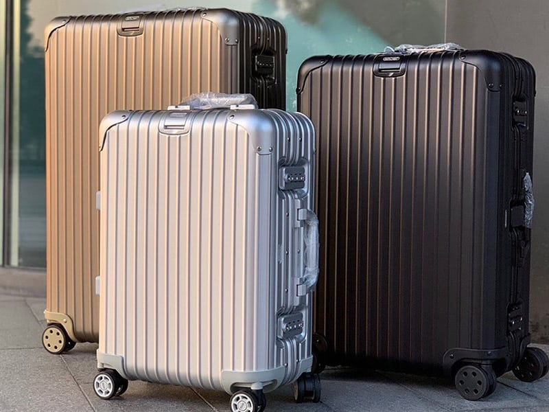 best zipperless suitcases compared side by side