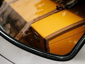 brown vintage style suitcase in a car trunk