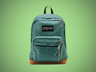 A teal college backpack on a green background