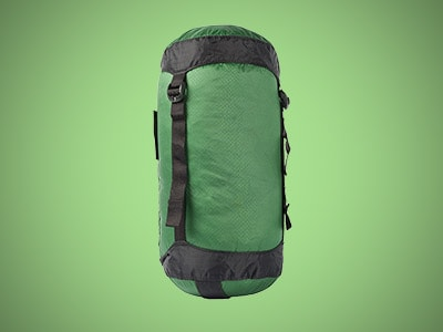 a green compression sack on a green background