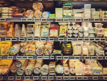 dairy foods stacked in a store shelf