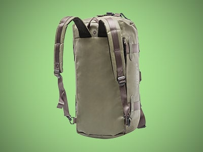 a gray duffel bag backpack on a green background