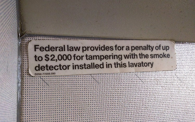 federal law penalty sticker for smoking on airplanes