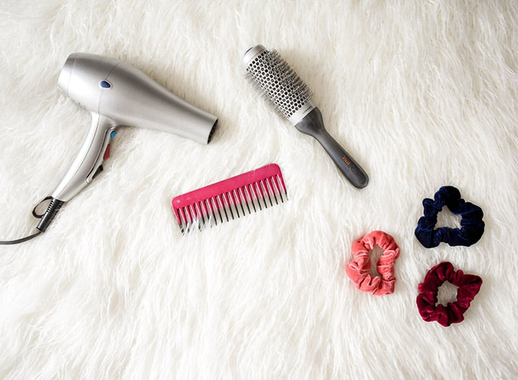 a hairdryer, conb, a hot-air brush, and other hair products