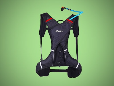 a black hydration pack on a green background