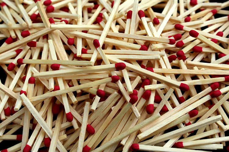 A pile of lighter matches scattered on the ground