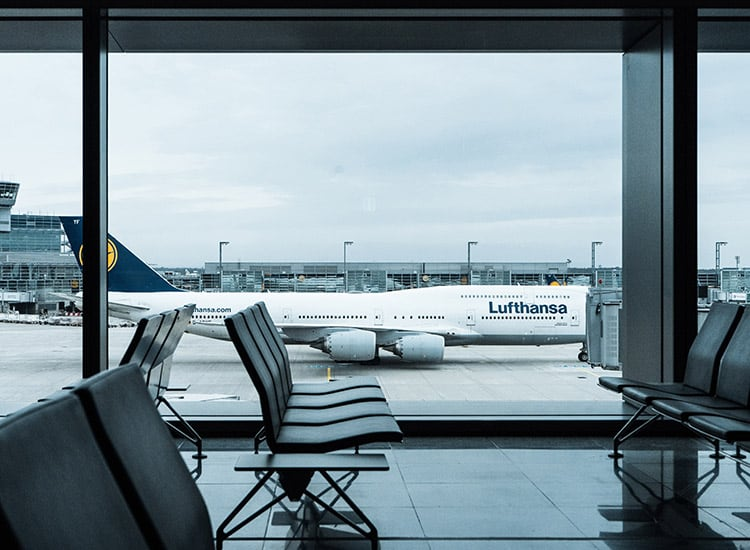 lufthansa airplane sitting at the boarding gate
