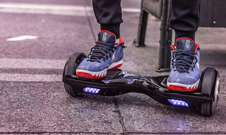 a man standing on a hoverboard