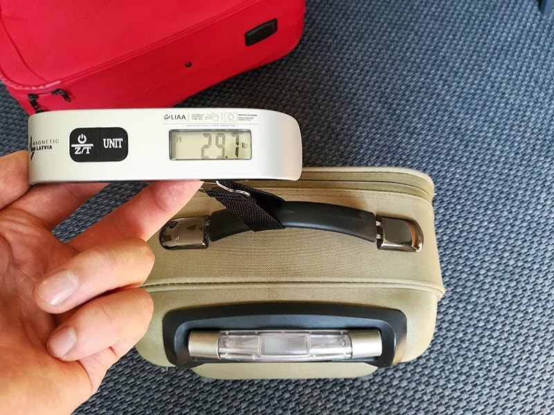 measuring luggage weight with a luggage scale