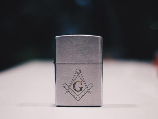 metallic zippo ligter on a white table