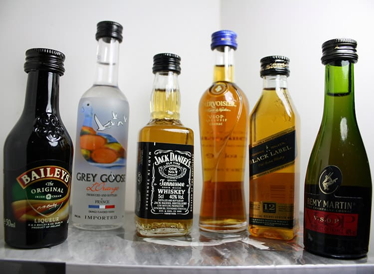 mini liquor bottles stacked in a line