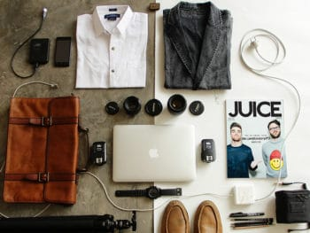 items laid out in flat lay for packing in checked luggage