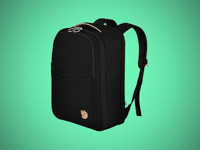 a personal item backpack on a teal background