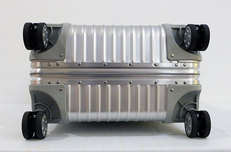 rimowa aluminum zipperless luggage with spinner wheels from the bottom