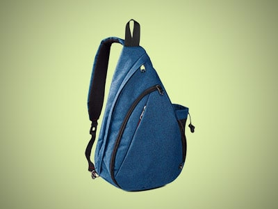 a blue sling backpack on a gray background