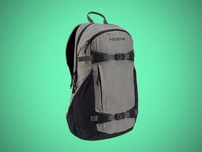 a gray snowboarding backpack on a teal background