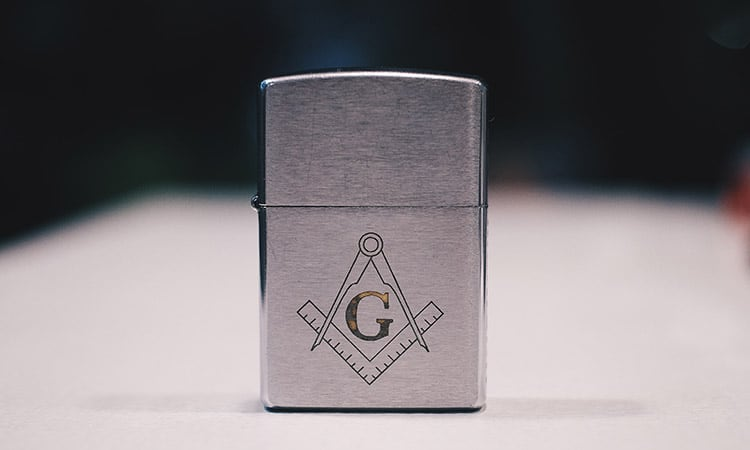 a stainless steel lighter on a dark background