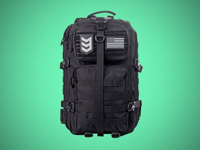 a black military tactical backpack on a teal background