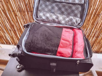 travelpro maxlite 5 opened suitcase with packing cubes