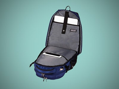 tsa approved laptop backpack on a blue background