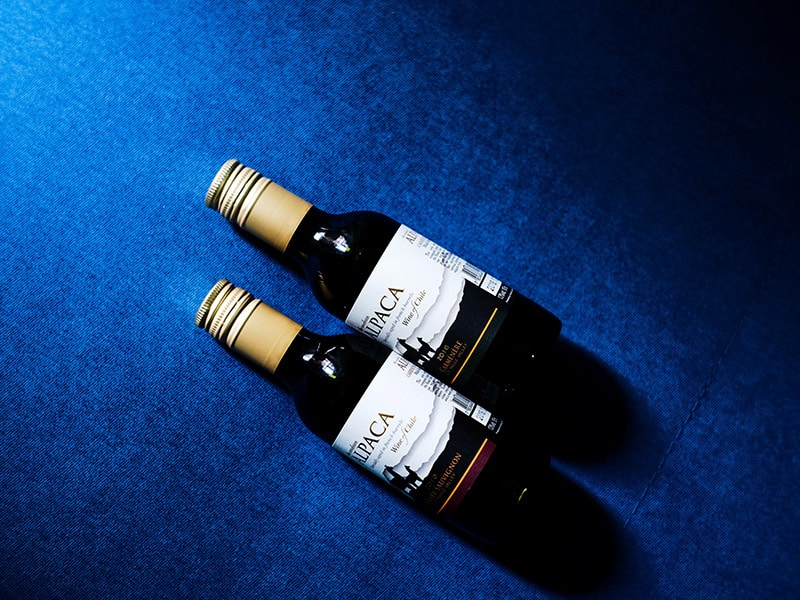 Two nips (mini alcohol bottles) on a blue background